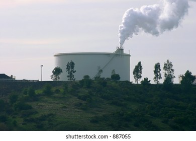 Refinery Tank with Smoke Stack
