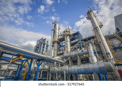 Refinery tower in petrochemical industrial plant with cloudy sky