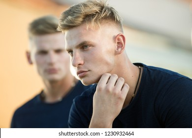 Refining your body shape. Handsome twins in casual fashion style. Pair of twins with muscular look. Muscular men in good physique. Athletic men outdoor. Fashion twins with fit body.