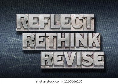 reflect rethink revise words made from metallic letterpress on dark jeans background