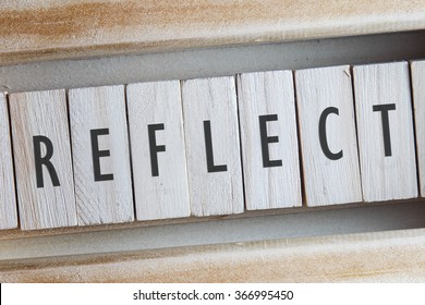 REFLECT word written on wooden