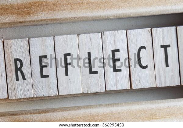 REFLECT word written on wooden