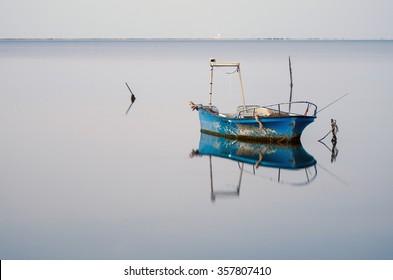 Reflected fishing boat