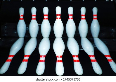 reflected image of Skittles for bowling,bowling game. Pins at the end of a bowling alley. skittles reflection
