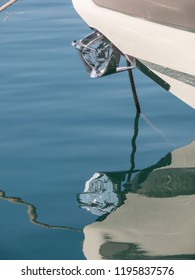 Reflected in the sea of the anchor of a boat
