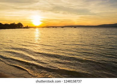 Reflected sunset on the sea in Arousa Island