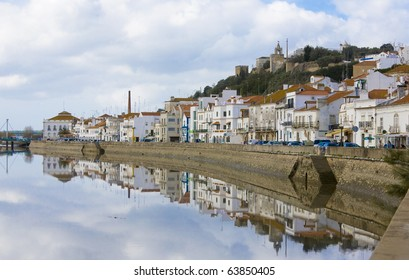 Reflected view over Alcacer do Sal, a typical village on the margins of the Sado river, Setubal, Portugal