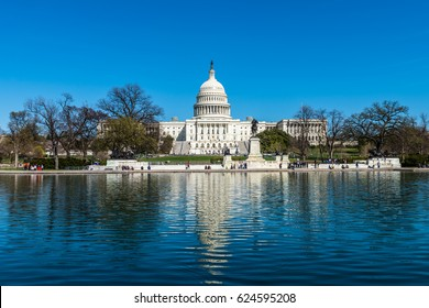 The reflecting pool in front of the United States Capitol Building in Washington DC.