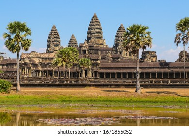 Reflection of Angkor Wat temple in the water. Cambodia. Beautiful reflection of the majestic Angkor Wat in a pond with water lilies