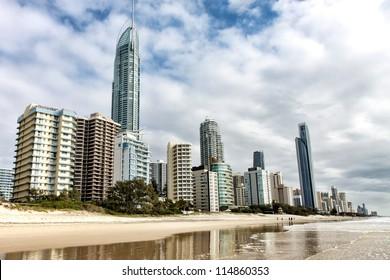 Reflection of apartments in sea at sunrise, Gold Coast, Australia