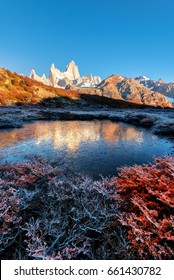 Reflection of autumn mount Fitzroy in the frozen water. El Chalten. Andes. Patagonia. Argentina.