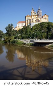 Reflection of baroque abbey church in stream,  Melk, Austria