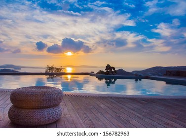 The reflection of the beautiful clouds in the pool at sunset and the island ... Greece.
