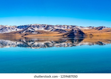 Reflection of the beautiful mountain in autumn on the crystal clear cold water in The Lake Tolbo near Ulgii in Western Mongolia