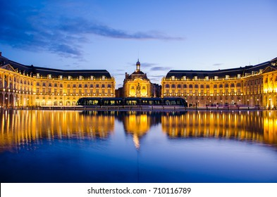 Reflection at blue hour of the Bourse Place with tramway in Bordeaux
