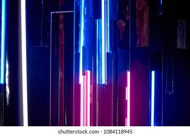 The reflection of blue and pink light at the surfaces. The atmosphere of the club, the parties. Twilight