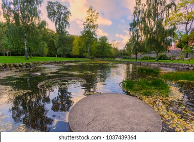 Reflection of blue sky in pond during spring,gothenburg,sweden