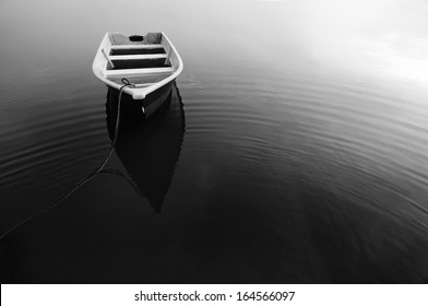Reflection of Boat During in Black and White