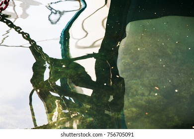Reflection of boats in sea water in Balaclava