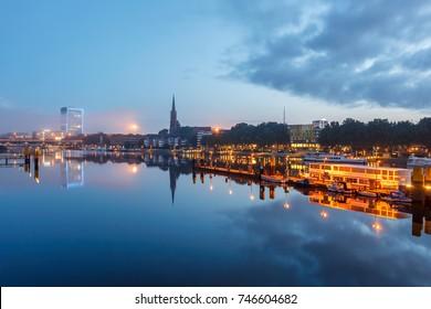 Reflection of Bremen Landmarks in river Weser, Bremen Germany.