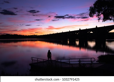 A reflection of a bridge during a beautiful sunset over the Susquehanna River in Lancaster, PA.