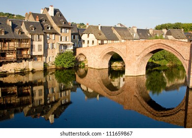 Reflection of the bridge of Espalion in Aubrac, France