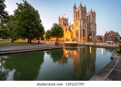 Reflection of a Bristol Cathedral in a pond with a fountain