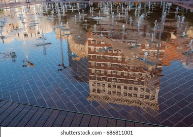 Reflection of a building in downtown Fort Worth, Texas. Sundance square fountains on a brick walkway and the reflections of the city. Horizontal orientation.