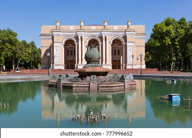 Reflection of the building of Navoi theatre in the water of the fountain, Tashkent, Uzbekistan.