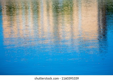 Reflection of a building on the surface of water