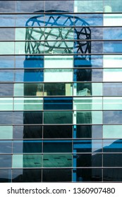 A reflection of a building shown on a glass building in Salford Quays, Manchester, England