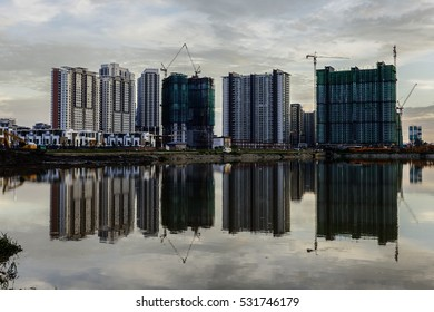 Reflection of building under construction in a lake in Malaysia.