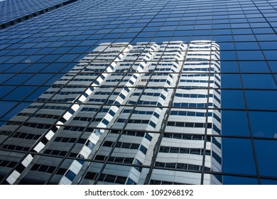 Reflection Buildings on blue glass