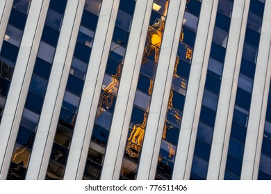 Reflection of bulding crane in the windows of an adjacent building.