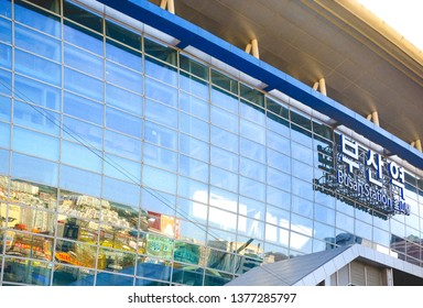 A reflection of Busan City on the glass facade of Busan Train Station, Busan, South Korea, December 2018