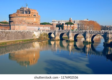reflection of the Castle Sant'Angelo and the bridge Sant'Angelo in the river Tiber, Rome, Italy