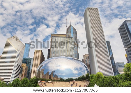 Reflection of a Chicago buildings in a mirror of Chicago Bean, Millennium Park, Chicago city, USA.