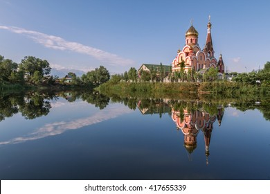 Reflection of a church in Almaty, Kazakhstan known as Church of exaltation of the holy cross.