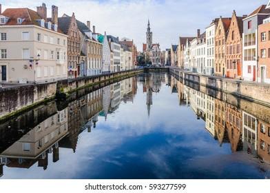 Reflection of church in Jan Van Eyckplein in the UNESCO World Heritage Old Town of Bruges, Belgium