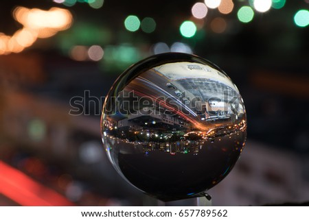 A reflection of a city in a crystal ball