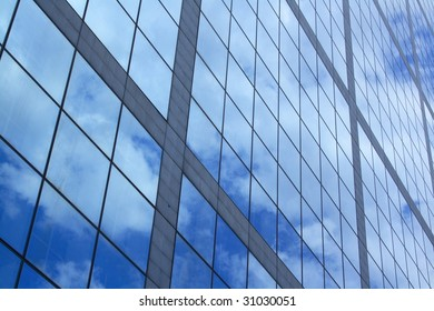 Reflection of clouds in a blue sky on windows
