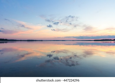 Reflection of clouds in a lake at sunset in Saadjarv in Estonia.