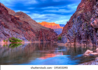Reflection in Colorado River of Butte catching days last rays, in Grand Canyon.