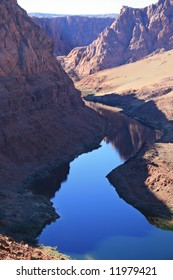 reflection of the Colorado River near Lees Ferry as it exits Glen Canyon