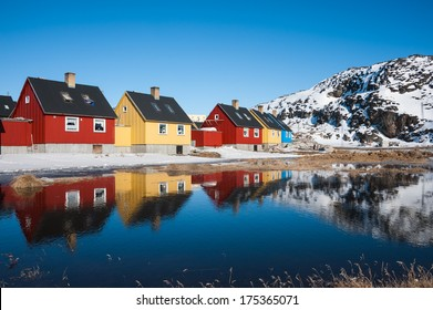 Reflection of colorful houses in Greenland.