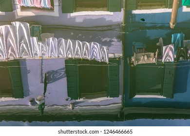 Reflection of colourful houses on the island of Burano, Italy