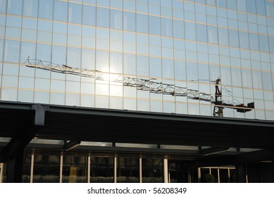 A reflection of a crane in windows