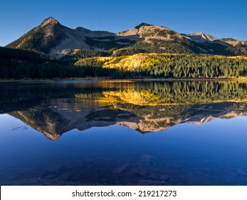 Reflection of East Beckwith Mountain in lake, west of Crested Butte, Colorado