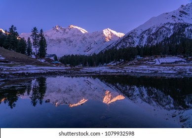 Reflection of Fairy meadows during the sunset period with  Nanga parbat mountain range , gilgit-baltistan , Pakistan
