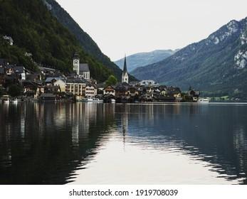 Reflection of famous traditional village of Hallstatt in Upper Austria at the calm Lake Hallstatt